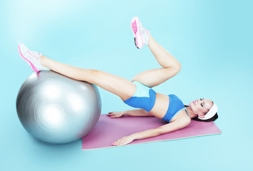 Workout. Active Woman exercising with Fitness Ball