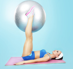 Gym. Wellness. Sporty Woman with Fitness Ball