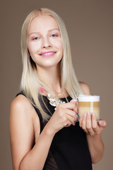 Pleasure. Woman Blonde holding Cup of Morning Cofee