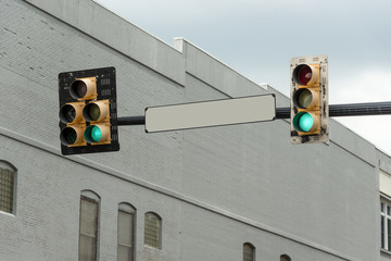 Blank Street Sign With Green Light
