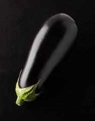 Eggplant isolated on the black fabric background