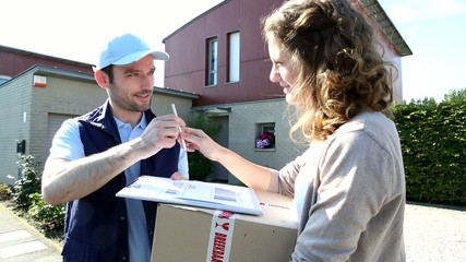 Young attractive woman happy to receive parcel
