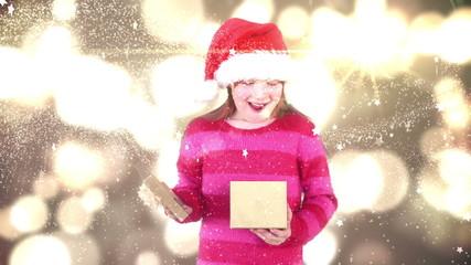 Festive little girl opening magical christmas gift