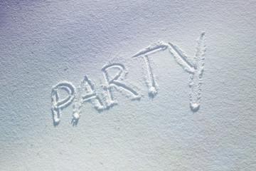 Party word handwritten on snow