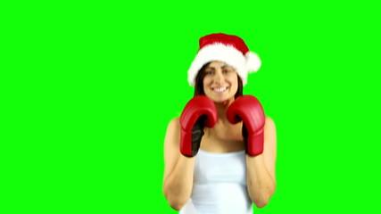 Festive brunette boxing to camera