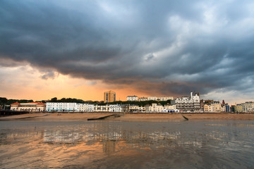 Evening view of the seafront in Hastings, East Sussex, UK.