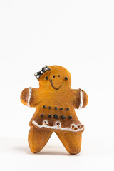 A Christmas woman cookie statuette with bow and skirt