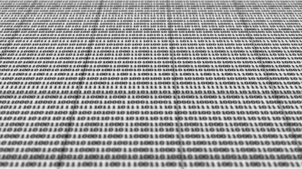 Scrolling black and white binary code