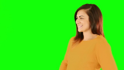 Happy brunette blowing over hands