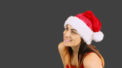 Festive brunette blowing over hands