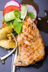 Grilled salmon fish fillet steak with vegetable
