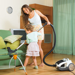 Family with vacuum cleaner