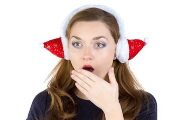 Photo of surprised woman in winter headphones