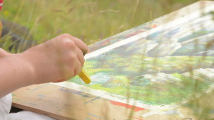 artist sketching nature scene in summer meadow