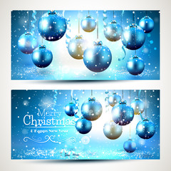 Blue christmas banners with snow-covered decorations