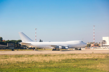 Big Cargo Airplane at Airport Parking Area