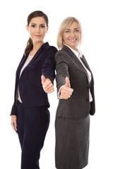 Erfolgreiche Arbeit im Team: Business Frauen mit Daumen hoch