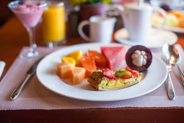 Healthy breakfast with juicy fruits and black coffee