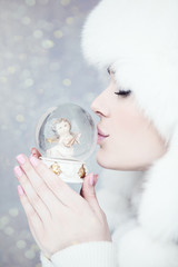Winter woman making wish