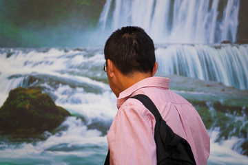 Man looking waterfall