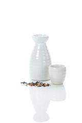 white jug and shot of sake and bulk of tea