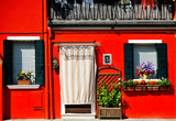 Venice, Burano island, painted red house, Italy