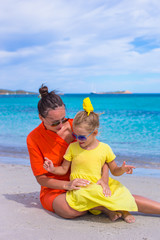 Happy mother and daughter during tropical beach vacation