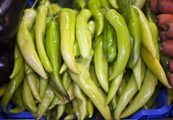 Hot green peppers in raw at a farmers market