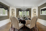 Dining room with white cabinetry