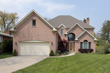 Brick home with arched window