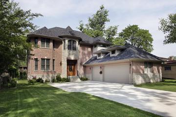 Brick home with three car garage