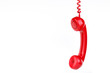 Classic red phone on white background. - 72744545