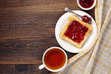 Tea and toast with jam