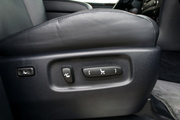 Buttons for adjusting seat position. Car interior.