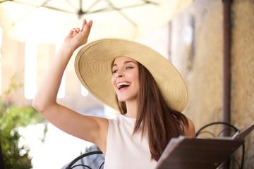 Young women calling the waitress