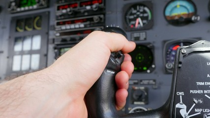 Pilot Resting Hand on Yoke During Flight POV