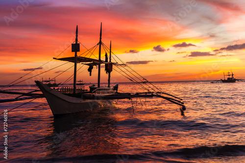 sail boat at sunset sea, boracay island, philippines - 72746926