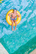 Swimming, summer vacation - lovely child boy playing in blue wat