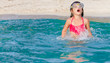 young child girl snorkelling in mask on tropical beach backgroun