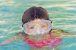 young child girl snorkelling in mask