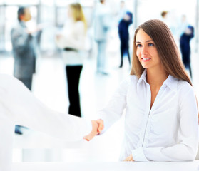 businesswoman and client handshaking