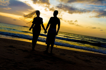 young loving couple on wedding day on tropical beach and sunset