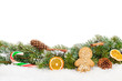 canvas print picture - Christmas food and decor over snow fir tree
