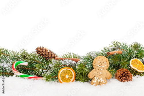 canvas print picture Christmas food and decor over snow fir tree