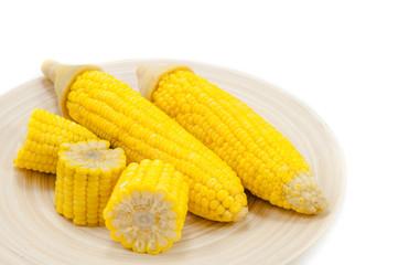 Sweet boiled corn on wood bowl on white background