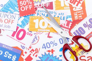Money saving coupon vouchers with scissors