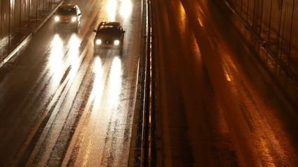Wet Rainy City Road at Night