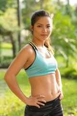 Portrait of fit Vietnamese girl wearing sports bra
