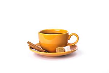 Orange mug with cinnamon and sugar
