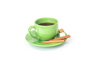 Green mug with cinnamon and sugar